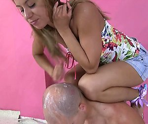 Domme is spitting on slaves bald head covering him with saliva