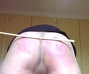 caned in pantyhose