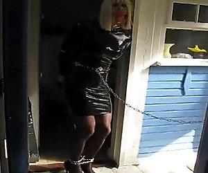 PatsyPVC in bondage, ballgagged, captured in tight PVC dress