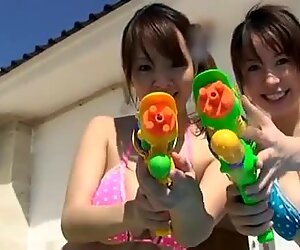 Chubby and busty Japanese gal Hitomi Tanaka has fun with water pistols