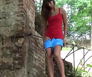 Skinny raven haired slut in red top pissed outdoors