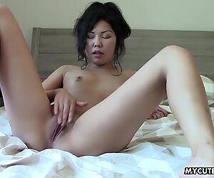 Super sweet and hot Asian shows off her body