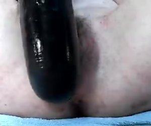 My pussy filled with a huge dildo