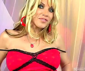 Hot blonde Angie Savage plays with her big boobs on the couch