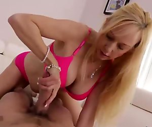 Big-titted milf POV handjob
