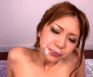 Thick cum on sweet Japanese girl's good face.