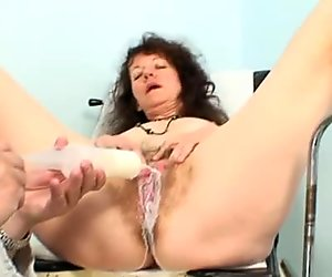 Frisky brunette mom Karla pounds her bearded pussy with dildo