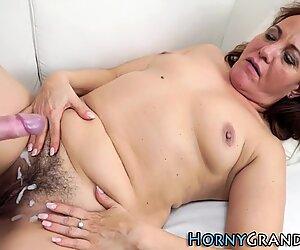 Grandma sucking on cock