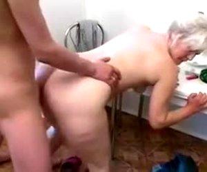 Mature blonde sucks my buddy's cock and enjoys rear banging