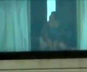 follando en la ventana del hotel