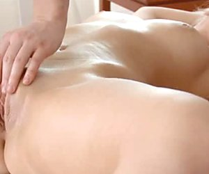Busty blonde bombshell gets her pussy fingered by her masseur