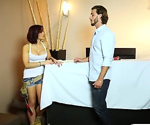 Busty woman enjoys much younger guy for a slutty massage