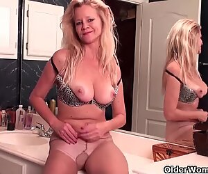 Mature soccer mom with D-cup tits masturbates in pantyhose