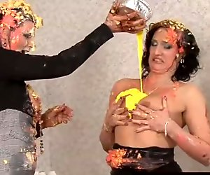 Clothed chicks play with food and get messy