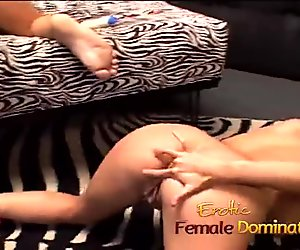 Dominatrix sucks her slaves cock while toying with his asshole