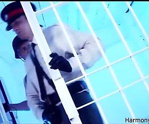 Frisky brunette gives blowjob in a jail cell