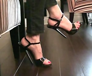 Bending and tapping a 6 inch stilettos black sandals