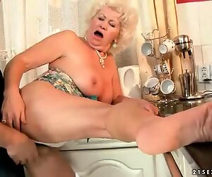 Old bitch giving footjob and getting fucked