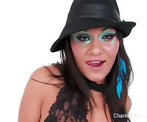 Brunette bombshell Charley teases and dances for the camera