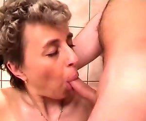 Busty granny sucks grandpa's tiny cock
