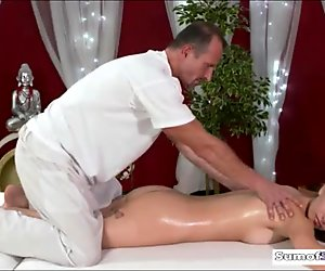 Horny masseur fucked her stunning client on massage table