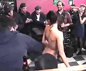 Bare babe tossed around from person to person in bar