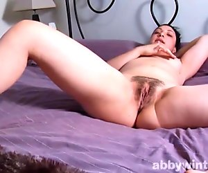 Teaser chick showing hairy pussy