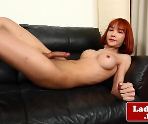 Redhead ladyboy shows off her sweet asshole