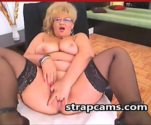 Granny in sexy lingerie undressing On Cam