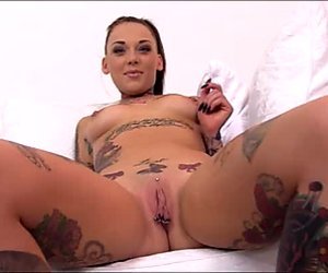 Jaw dropping tattooed whore spreads legs wide to expose juicy slit