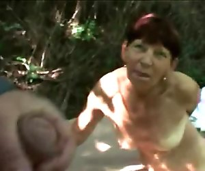 Nasty mature slut masturbates in a forest before a stranger drills her hairy pussy