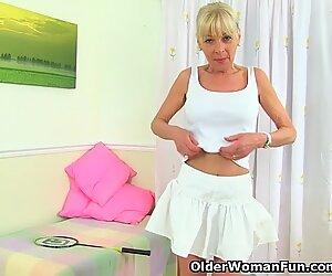 English gilf Elaine sticks a badminton racket up her pussy